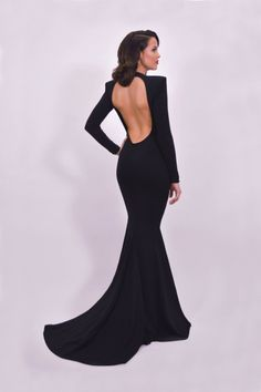 Black jersey mermaid gown with strong shoulders and open back.-For best fit, scroll down to see theMichael Costello Size Chart- When choosingheight, include theinchesof yourheels