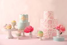 """Right to Left: Delicate pastel cupcakes are available in a variety of flavors and are a charming departure from a traditional wedding cake (The Kupcake Factory). Adorned in Tiffany-blue homemade fondant and embellished with edible miniature jewels, this cake also features a layer of buttercream frosting from NOLA Belles Bakery. This decadent, triple-layer """"Princess"""" cake with pink and white fondant icing features a whimsical, contemporary design from The Cocoa Bean Bakery & Café."""