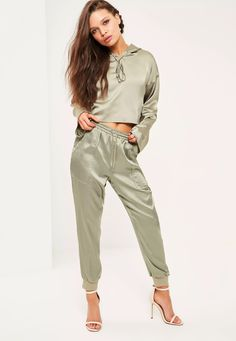 "Good things come in small packages. Shop our Missguided petite range, for babes 5""3 and under.   For sports luxe vibes, you need these fierce sage green satin joggers with pockets and adjustble waist."