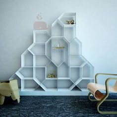 Img01 @saket_group #hyderabad #telangana : A #bookcase made from house-shaped modules that connect together with magnets to create a shelf that works for you.  http://www.facebook.com/saketgroups