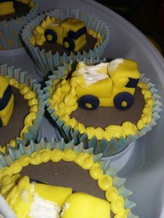 Baby shower cupcakes with a yellow digger theme for baby boy. close up tplh