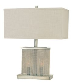 Cascading strands of beads add a touch of embellishment to the brushed nickel body of the Gymnopedie lamp from @thumprints, topped by a rectangular linen hardback shade ($506).