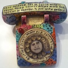 Howard Finster telephone.  What wonderful investigations would a great Math Teacher paint on a phone like this one?  Imagine and Create.