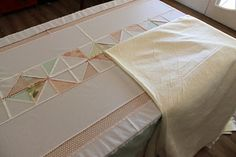 Narioka: Pin basting quilts on the dining table