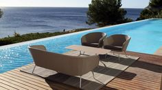 Shell Sofa, designer outdoor lounge sofa for luxurious lounging in garden or by the pool. Manufactured by FueraDentro - exclusive outdoor design furniture.