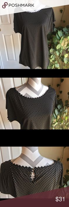 Ann Taylor black w/ tan polka dot pullover top So pretty!  Only worn 1 time!  Great detail; wear with jeans; under a jacket or cardigan.  70% rayon and 30% lyocell. Ann Taylor Tops