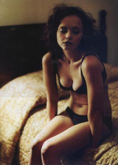 The dreaded wake-up call clears a little of the bourbon and rye haze, so she lingers on the edge of the hotel bed for a moment, almost unwilling to return to the world of pot roast dinners, laundry and girl scout meetings. (photo of Christina Ricci)