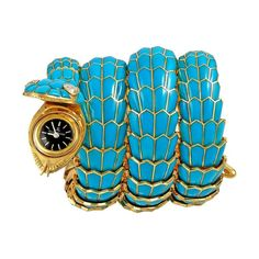 From the vintage Bvlgari archives: Yafa signed Bulgari Serpenti bracelet watch with turquoise, diamonds and a Jaeger-LeCoultre mechanical movement, circa 1960s. Discover more: http://www.thejewelleryeditor.com/vintage/antique-snake-jewellery-bulgari-cartier/ #antique