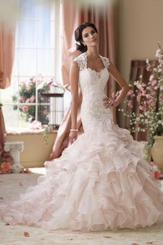 Absolutely adore this lace, tulle mermaid wedding dress! #weddingdress #gown {David Tutera for @moncheribridals}