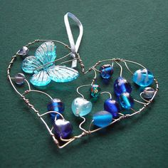 Blue Heart with butterfly - a beaded suncatcher *sold* by Sneddonia, via Flickr