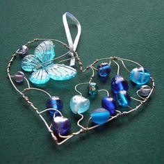 Blue Heart with butterfly - a beaded suncatcher *sold* by Sneddonia, via Flickr