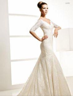La Sposa Landa: quater length sleeve, lace, mermaid.