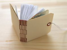Long stitch binding on a mini book This style could be used to make a sketch book.