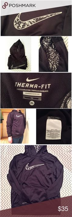 """🆕 Listing⚜️NIKE Camo Hoodie Woman's Med This Nike Therma-Fit Camo Hoodie is like new! Very comfy and warm.  I think it's actually a boys XL, but it fits like a woman's Med. that's me wearing it in the photo, I'm an extra small. Measurements are: bust-40"""" Length-24"""" Sleeve-21"""" Deep black. Great condition. Polyester. Machine washable. Nike Tops Sweatshirts & Hoodies"""