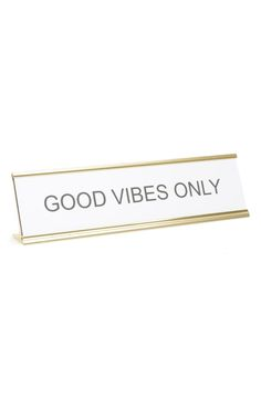 Sticking to the motto while at work with this clever desk sign that lets everyone know, good vibes only.
