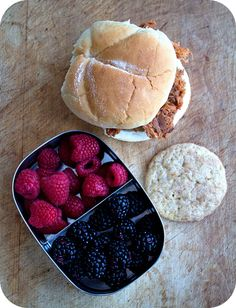 Easy lunch box ideas: barbecue pulled pork sandwich; snickerdoodle cookie; and raspberries and blackberries. http://www.LunchBoxBlues.com
