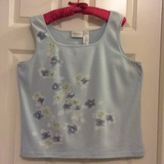 Top-Pale Blue with flowers This top is extremely comfortable soft fabric with stretch. Satin edges on neckline and arms, soft pale blue and Seafoam green pansies. L-XL. Liz Claiborne. Liz Claiborne Tops Tank Tops