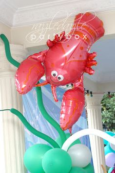 Balloon Columns With Sea Creatures Under The Red