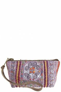 Enhance your wardrobe with this #CalypsoStBarth unique hand embroidered wristlet