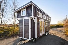 Best layout yet. This is a tiny house on wheels built by Tiny Living Homes with a big kitchen and a double sink vanity in the bathroom which makes it a great tiny home to share. From the outside, you'll see i… #tinyhomeideaslayout #tinyhousekitchenlayout #tinyhomekitchenlayout