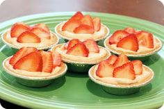 store bought mini crusts, cool whip, strawberry yogurt, strawberries - add some cream cheese and perfecto