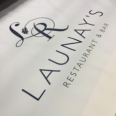Café Banner for Launay's Restaurant. White canvas with a white vinyl logo.