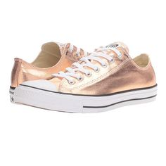 Converse Chuck Taylor All Star Metallic Canvas Ox: Whether you already have a shoe-rack full of Chucks or you've never owned a pair (what are you waiting for?) your wardrobe is begging for this rose gold update. Wear them with jeans, a skirt, a party dress, or anything else in your closet—they're that versatile.
