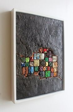 Surfaces life has its dimensions in the mysterious An abstract wall sculpture of concrete mixed with black pigment, acrylic and resin, with geometric designs, Hanging accessories are included. Sculpture Clay, Wall Sculptures, Geometric Art, Geometric Designs, Abstract Wall Art, Abstract Portrait, Portrait Paintings, Acrylic Paintings, Contemporary Artwork