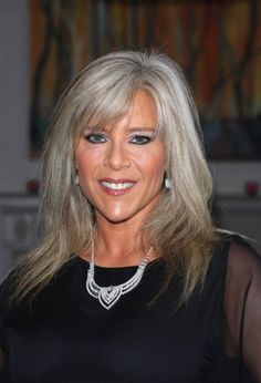 Sam Fox looks lovely with this conservative, well-maintained grey hairstyle. Photo courtesy WENN.