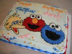 Sesame Street Birthday - 1/2 sheet cake with Big Bird, Elmo, and Cookie Monster drawings.