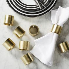 Shop set of 8 scott gold napkin rings.   Cast aluminum rings with modern brushed texture resemble a cool piece of wrist candy.  Shiny, but not too shiny, gold brings a sophisticated polish to the table.