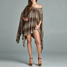 SEXY Leopard print swing dress / top sizes S, M, L ONLY ONE IN EACH SIZE Small Med and large just request size COTTON POLY BLEND NEW SWING TOP / DRESS IN LEOPARD PRINT   I CAN SPECIAL ORDER SIZES XL- 3 XL AS LONG AS SUPPLIES LAST.  Price is firm. No trades Sherri Souza Boutique Dresses Midi