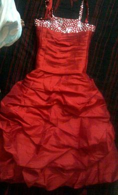 Red gown for a young girl