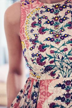 Stylist - I love the embroidered detailing on this dress and the color palette