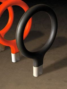 Santa & Cole - Key Bicycle racks:  Designed to resemble the head of an antique key, Key is made by the Barcelona atelier Lagranja. It has a cast-iron base and a steel outline that is finished with polyurethane integral foam. Available in red or anthracite grey. Ameico, 1 Church Street, New Milford, CT 06776; 860-354-8765; ameico.com.