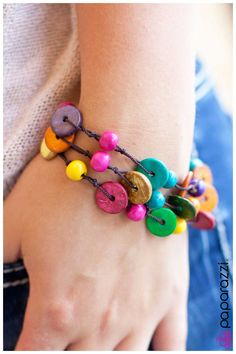A Blast of Boho Item #: P9WH-MTXX-002XX Wooden beads and rings in a multicolored finish are tied into three layers with brown twine for a gorgeous colorful look. Features a sliding knot closure.  Sold as one individual bracelet.