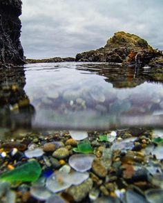 Glass remains from garbage. How the power of water re-shapes man's wanton waste & refuse into beauty.