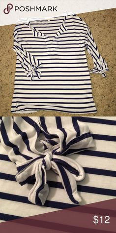 Charming Charlie nautical top this 3/4 sleeve top with tie accents is a comfy summer staple. the lightweight and flowy material make it great to wear all year round, layered, or by itself. Charming Charlie Tops