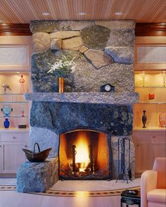 Freshwater Stone: mixed field stone and granite fireplace | Elliot & Elliot Architecture | Deer Isle, Maine