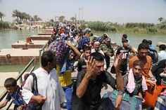 The U.S. Ignored Ramadi, Now It's Bombing the Hell Out of It — War Is Boring —  Civilians flee Ramadi on May 20, 2015 after the city fell to Islamic State. Karim Kadim/AP photo