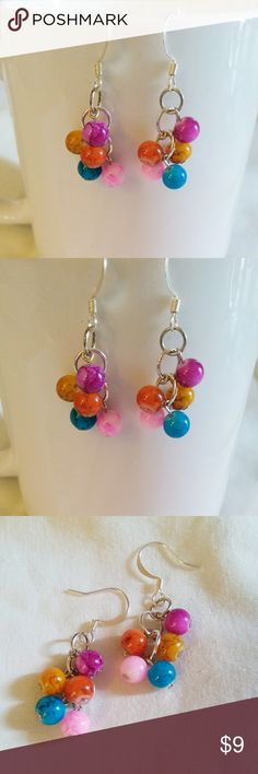 ❤️New❤️ Tiny Clusters Dangle Earrings Tiny marbled cluster dangle earrings  Hot Pink, purple, yellow, orange, blue.  Tiny marbled acrylic beads. Same color on each earring. 5 beads on each earring.  Sterling plated hardware. Fish Hook backings.  ****** 3 available ******  Mana's Magic Designs original handmade by me. Jewelry Earrings