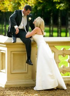 """Photographing you 1st wedding. """"I asked the groom to hop up on the pillar and I shot this frame into the light. Be dynamic with your posing and great pictures will result. ISO 400 f/4 at 1/500th"""""""