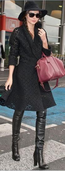 Who made Miranda Kerr's thigh high black boots, black hole dress, red handbag, and black sunglasses? Dress and shoes – Azzedine Alaia  Purse – Louis Vuitton  Sunglasses – Flynt