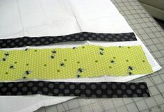 Tutorial for sewing decorative borders onto a kitchen towel.