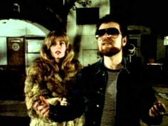 Blue Oyster Cult - Take Me Away - YouTube. Cool song & video from the 80's with a great Sci-Fi theme.