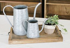 Nothing says Spring like Watering Cans!! Perfect for any Porch, Patio, Potting Shed or Garden Area!! Rustic, Farmhouse, Industrial Farmhouse, Vintage, Fixer Upper Style. Get these and More from www.rustandrelics.net!! The BEST place to shop Industrial Farmhouse Decor!!