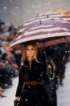 "Burberry.  Well this young lady did not take my advice when I suggested ""oh let a smile be your umbrella"". She is intelligent not to because she will not get wet!"