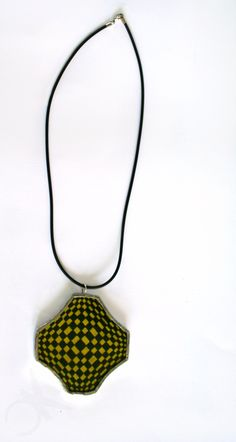 Glass necklace double face, handmade in Tiffany tecnique and optical fabric, yellow and black. #glassnecklace #psychedelicneclace #freetobeunique #handmadein Italy #originaldesign #unisexjewel  https://www.etsy.com/listing/237522433/yellow-and-black-double-face-necklace