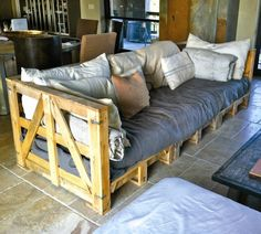 Pallet Sofa.  I need to have one made.  It's so hard to find a sofa that I really life.  Most are hard when you sit on them and are uncomfortable to really sit back and enjoy on.  This way, I can have it just the way I like it.....SOFT AND COMFY!