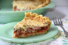 Tomato pie, using simple fresh ingredients - juicy tomatoes and fresh herbs, layered in a flaky pie crust, with sweet onion and cheese. Dr...